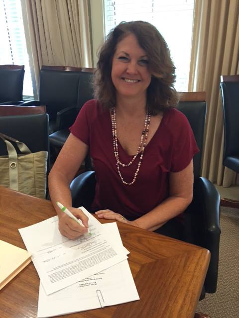 Chair, Diane Murphy, Signing Lease to Purchase Agreement with the Eureka Springs School District